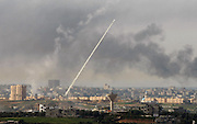 A rocket fired by Palestinians Hamas militants in the Gaza Strip flies towards an Israeli target as seen from the Israel-Gaza broder in southern Israel