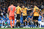 Captain Wolverhampton Wanderers midfielder Conor Coady (16) gets the team in for the huddle during the Premier League match between Everton and Wolverhampton Wanderers at Goodison Park, Liverpool, England on 1 September 2019.