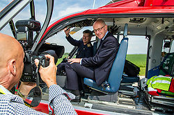 Pictured: Pilot Ric Stell and John Swinney<br /> Deputy First Minister and local MSP  John Swinney visited Perth Airport today to visit Scotland's Charity Air Ambulance. The Perthshire North MSP will meet volunteers and present certificates to mark the start of National Volunteers' Week.<br /> <br /> <br /> Ger Harley | EEm 1 June 2018