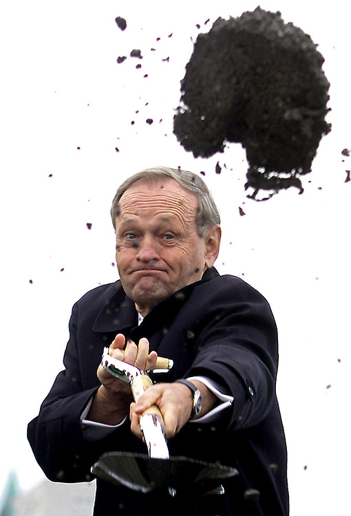 Canadian Prime Minister Jean Chretien shovels dirt at a ground breaking<br /> ceremony for the Canadian War Museum in Ottawa, November 5, 2002.  REUTERS/Jim Young