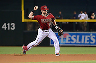 PHOENIX, AZ - AUGUST 03:  Chris Owings #16 of the Arizona Diamondbacks throws the ball to make the out at first against the Washington Nationals during the first inning at Chase Field on August 3, 2016 in Phoenix, Arizona. The Nationals beat the Diamondbacks 8 to 3.  (Photo by Jennifer Stewart/Getty Images)