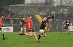 Michael Gibbons tries to block the shot of Glenbeigh's Stephen O'Sullivan.<br />