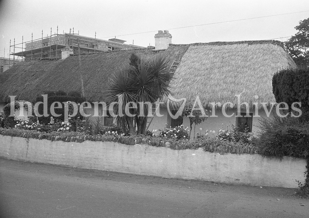Thatched cottage on Blackhorse Avenue with construction in the distance in Dublin, September 1972.<br />