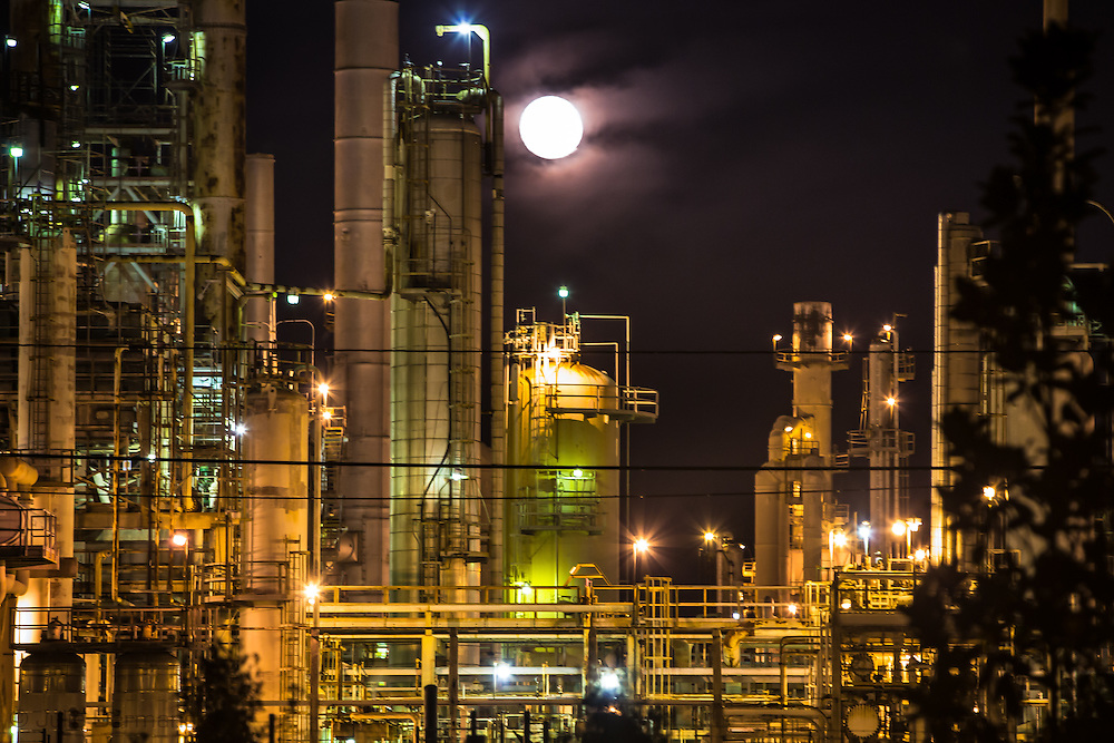 Supermoon rises behind the Valero Energy refinery in Meraux, Louisiana.