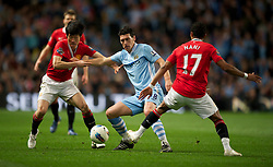 MANCHESTER, ENGLAND - Monday, April 30, 2012: Manchester City's Gareth Barry in action against Manchester United during the Premiership match at the City of Manchester Stadium. (Pic by Chris Brunskill/Propaganda)