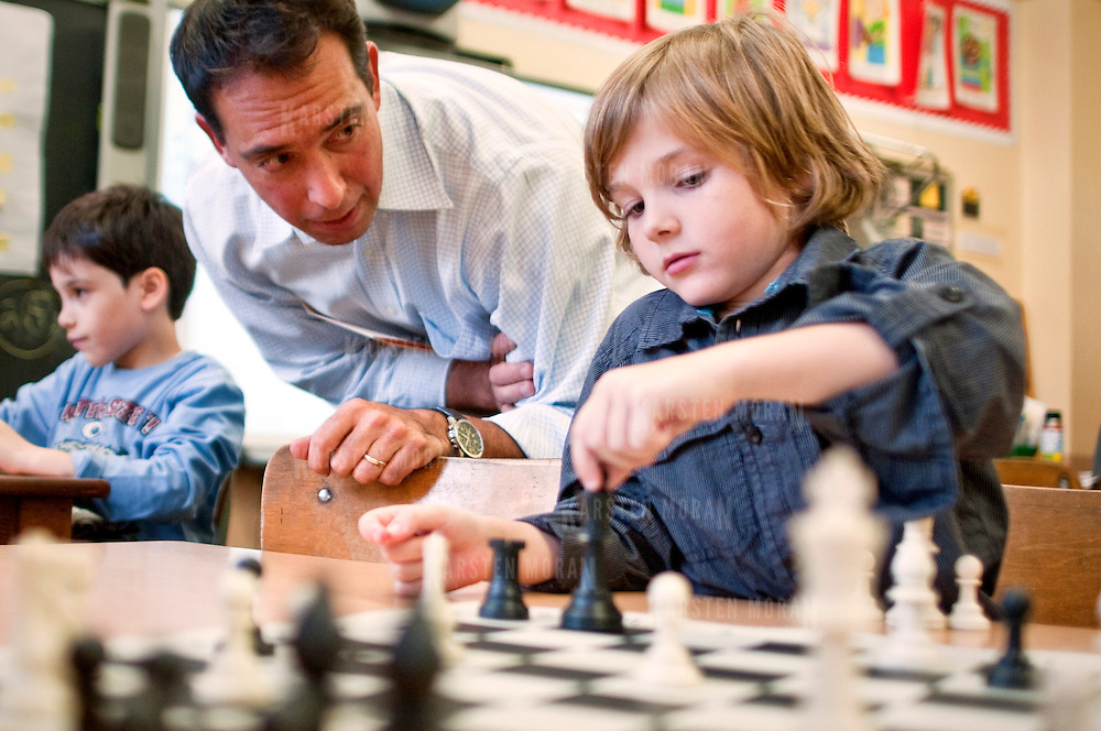 October 14, 2010 - Bronx, NY : P.S. 24 science teacher Walter Rendon works with second grader Vaughn Stout during a lunch-hour chess club session on October 14.