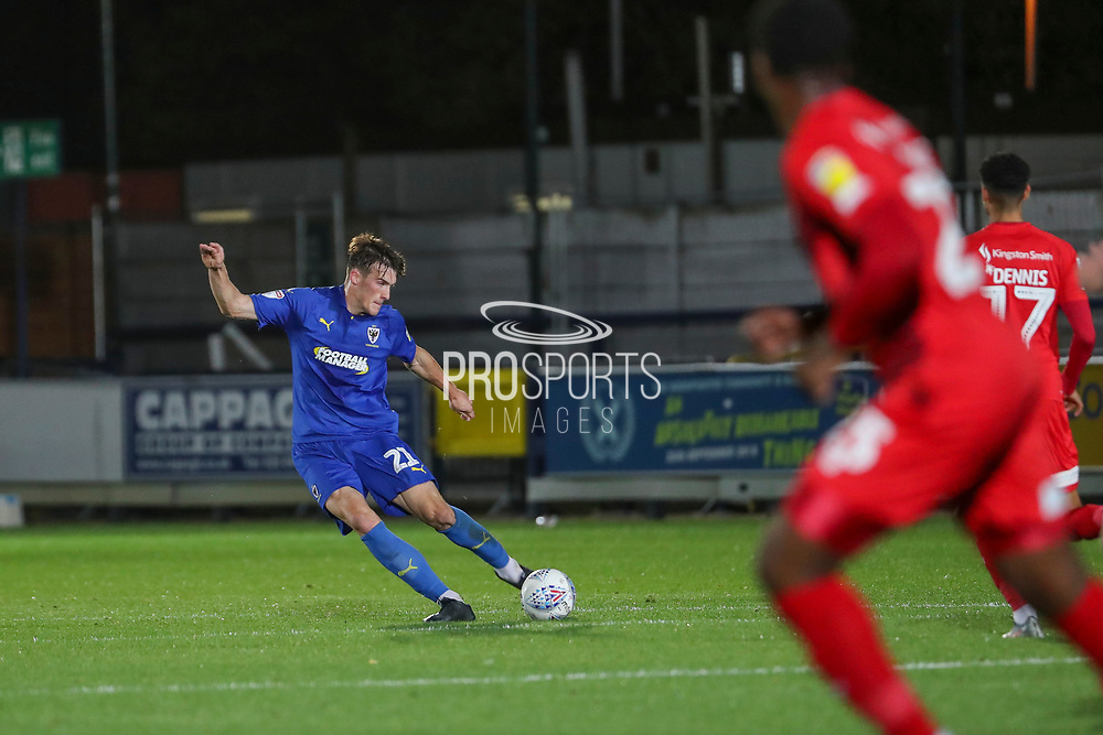 AFC Wimbledon defender Ryan Delaney (21) passing the ball during the Leasing.com EFL Trophy match between AFC Wimbledon and Leyton Orient at the Cherry Red Records Stadium, Kingston, England on 8 October 2019.