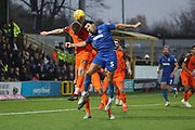 AFC Wimbledon defender Will Nightingale (5) battles for possession with Southend United defender Taylor Moore (23) during the EFL Sky Bet League 1 match between AFC Wimbledon and Southend United at the Cherry Red Records Stadium, Kingston, England on 24 November 2018.