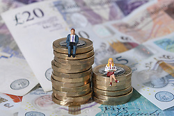 EMBARGOED TO 0001 MONDAY APRIL 15 File photo dated 11/9/2018 of models of a man and woman stand on a pile of coins and bank notes. Nearly two-thirds of people who checked their credit report after a bank IT failure said they uncovered errors that were not their fault, a survey suggests.
