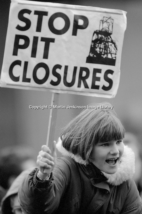 Young girl carrying Stop Pit Closures placard on a protest march.  Sheffield. 24 October 1992.