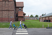 Two prisoners push their babies in prams through the grounds of the prison. HMP Styal, Wilmslow, Cheshire
