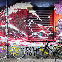 Street art and graffiti on wall of building in bohemian Friedrichshain in Berlin Germany