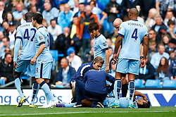 Sergio Aguero of Manchester City receives treatment after a knock - Photo mandatory by-line: Rogan Thomson/JMP - 07966 386802 - 30/08/2014 - SPORT - FOOTBALL - Manchester, England - Etihad Stadium - Manchester City v Stoke City - Barclays Premier League.