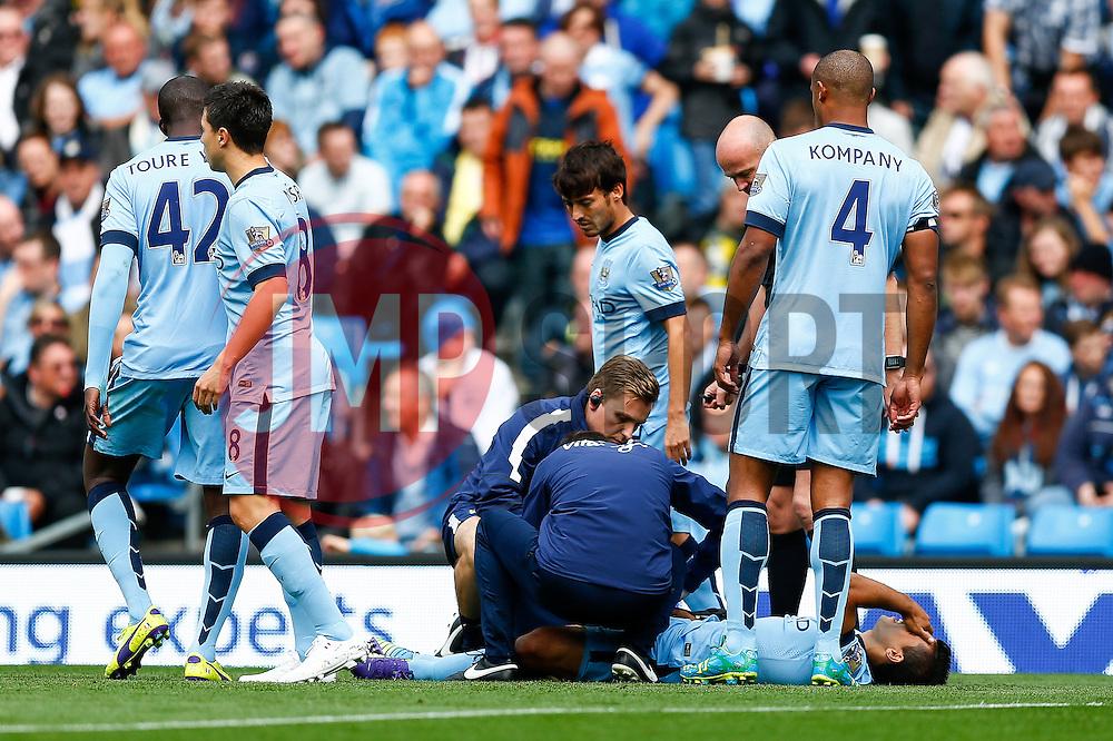 Sergio Aguero of Manchester City receives treatment after a knock - Photo mandatory by-line: Rogan Thomson/JMP - 07966 386802 - 30/08/2014 - SPORT - FOOTBALL - Manchester, England - Etihad Stadium - Manchester City v Stoke City - Barclays Premier League.