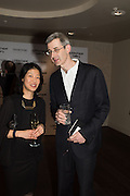 LYDIA YEE and EDMUND DE WAAL at the Whitechapel Gallery Art Icon 2015 Gala dinner supported by the Swarovski Foundation. The Banking Hall, Cornhill, London. 19 March 2015