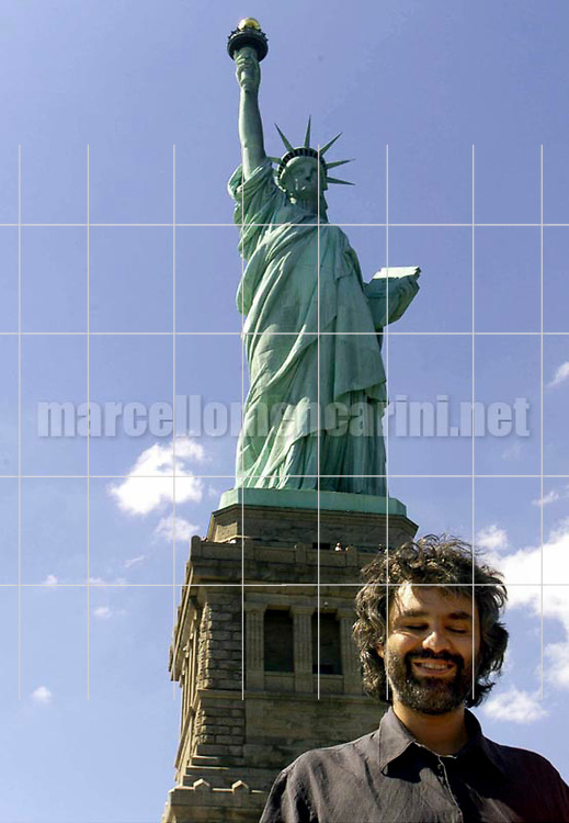 "New York, July 5, 2000. Andrea Bocelli poses in front of the Liberty Statue. He is in New York City to perform his ""Statue of Liberty Concert"" at New Jersey's Liberty State Park in honor of Italian immigrants / New York, 5 luglio 2000. Andrea Bocelli posa davanti alla Statua della libertà. E' a New York per il suo ""Concerto sotto la Statua della libertà"" nel Liberty State Park del New Jersey, in onore degli immigrati italiani - © Marcello Mencarini"