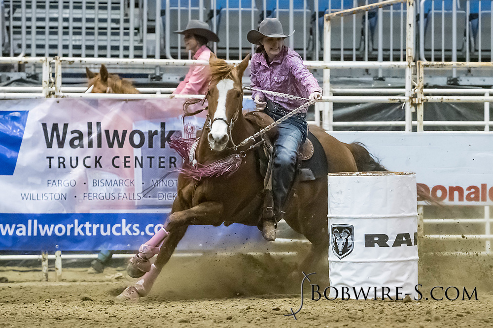 Barrel racer Tasha Thompson makes her run during slack at the Bismarck Rodeo on Saturday, Feb. 3, 2018. She had a time of 13.65 seconds. This photo and more from most runs are available at Bobwire-S.com.