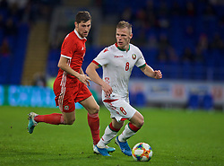 CARDIFF, WALES - Monday, September 9, 2019: Belarus' Nikolai Zolotov (R) and Wales' Ben Davies during the International Friendly match between Wales and Belarus at the Cardiff City Stadium. (Pic by David Rawcliffe/Propaganda)