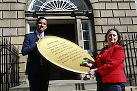 Scottish Labour deputy leader Anas Sarwar and credit union leader worker Alison Dowling deliver a giant pound coin to Bute House. The First Minister's official residence, to highlight uncertainty over what currency an independent Scotland would use.<br />