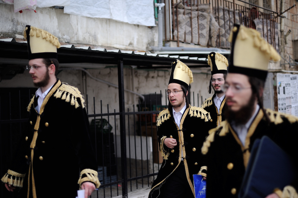JERUSALEM, ISRAEL - MARCH 17, 2014: Ultra-Orthodox Jewish men celebrate the Purim holiday in the ultra-orthodox Mea Shearim neighborhood in Jerusalem on March 17, 2014. The festival of Purim commemorates the rescue of Jews from a genocide in ancient Persia. Photo by Gili Yaari