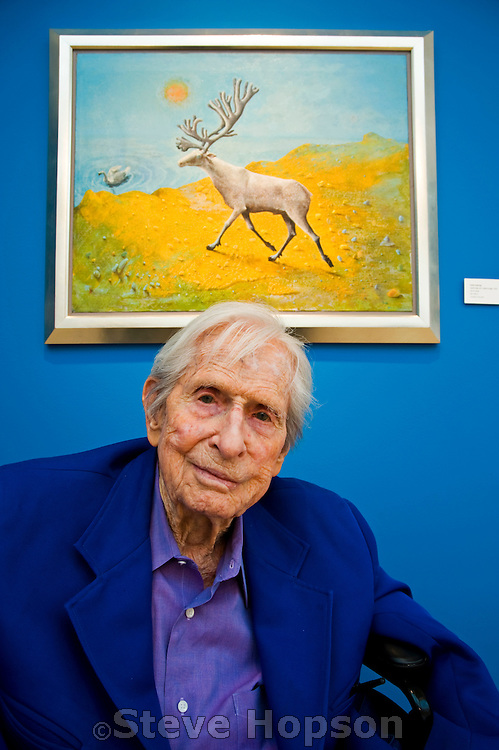 """Kelly Fearing at the opening of the Texas Biennial 2009 in Austin Texas, March 8, 2009.  Kelly Fearing has been an important artist working in Texas since the 1940s as a member of the Fort Worth Circle. After doing his graduate work at Columbia University in New York City, Fearing established himself as a surrealist painter and printmaker in Fort Worth, and then became one of the founding members of the art faculty at the University of Texas at Austin. He has had recent exhibitions at the Valley House Gallery in Dallas, Texas, and at the Archer M. Huntington Art Gallery in Austin, Texas. Fearing is now a Professor Emeritus at UT Austin and lives in Austin Texas. Fearing's painting, """"Spirit Deer at a Yellow Edge"""" is on the wall behind him in this photo."""