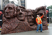 Frank Erdmann tries to win a year's supply of Jack Link's Jerky by taking a 'selfie' in front of Meat Rushmore, a 13-foot tall, 17-foot wide meat replica of Mount Rushmore National Memorial, on Thursday, June 12, 2014, in New York City's Columbus Circle. The structure, created from more than 1,600 pounds of Jack Link's protein-packed beef, pork and turkey jerky, was created to celebrate the third annual National Jerky Day. (Photo by Stuart Ramson/Invision for Jack Link's/AP Images)