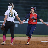Lauren Wood   Buy at photos.djournal.com<br /> Nettleton's Brittany Adams gets a high-five from Mooreville's Hallie Donald as she rounds the bases after hitting a home run during Tuesday night's 3A softball semifinal game. Nettleton defeated Moorville 28-13.