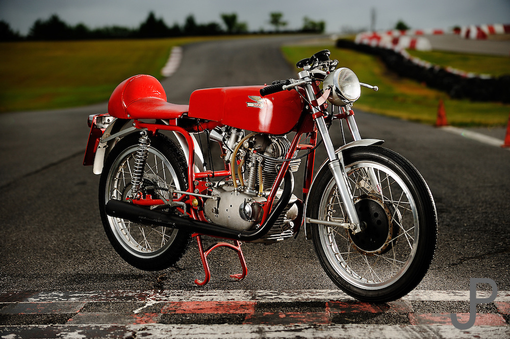 1967 Ducati Mach1/S 250cc motorcycle portrait at Hallett Raceway. This Forumula III Ducati 250 was one of only a dozen made and imported by Berliner for racing purposes only.  The gears are all straight cut and narrowed. The external oil lines to and from the head are unique to the FIII's.  The engine produced 35 HP at 9,000 RPM and ran approximately 135 mph.<br />