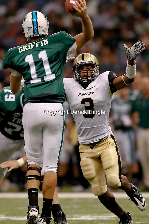 October 9, 2010; New Orleans, LA, USA; Tulane Green Wave quarterback Ryan Griffin (11) throws as Army Black Knights cornerback Antuan Aaron (3) pressures during the first half at the Louisiana Superdome.  Mandatory Credit: Derick E. Hingle