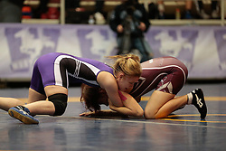 London, Ontario ---2013-03-02---  Nicole Mazara  of  Mcmaster takes on  Valerie Ouellette  of  Western in the women's 48 KG 5th/6th match at the 2012 CIS Wrestling Championships in London, Ontario, March 02, 2013. .GEOFF ROBINS/Mundo Sport Images