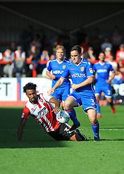 Jordan Cranston of Cheltenham Town is fouled by Jamie Gray of Stevenage- Mandatory by-line: Nizaam Jones/JMP - 02/09/2017 - FOOTBALL - LCI Rail Stadium - Cheltenham, England - Cheltenham Town v Stevenage- Sky Bet League Two