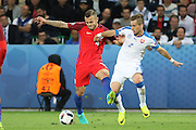 England Midfielder Jack Wilshere battles with Slovakia Defender Peter Pekarik during the Euro 2016 Group B match between Slovakia and England at Stade Geoffroy Guichard, Saint-Etienne, France on 20 June 2016. Photo by Phil Duncan.