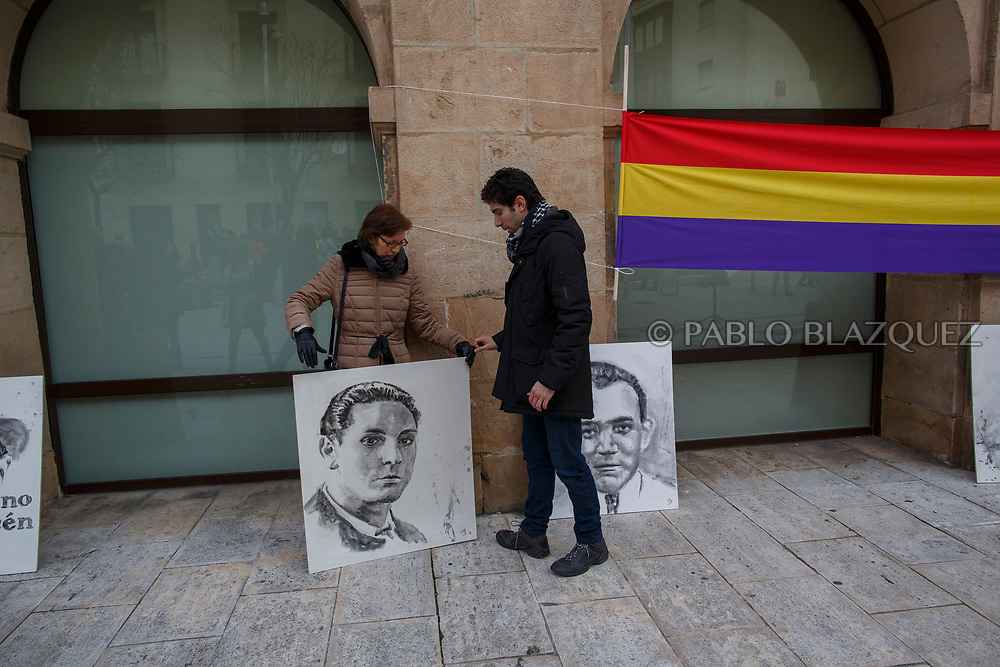 14/04/2018. A relative (L) and gran nephew Alberto Rodriguez Garcia (R) hold a portrait depicting Spain's Civil war victim Elicio Gomez during a homage to hand victims of Spain Civil War bodies exhumed in Cobertelada and Calata&ntilde;azor to their relatives on April 14, 2018 in Soria, Spain. La Asociacion Soriana Recuerdo y Dignidad (ASRD) 'The Soria Association for Memory and Dignity' celebrated a tribute to hand over the remains of civil war victims to their families. The Society of Sciences of ARANZADI helped with the research, exhumation and identification of the bodies, after villagers passed the information about the mass grave, 81 years after the assassination took place, to the ASRD. Seven people were assassinated around August 25, 1936 by Falangists, as part of General Francisco Franco armed forces, and buried in the 'Fosa de los Maestros' (Teachers Mass Grave) near Cobertelada, Soria, after being taken from prison of Almazan during the Spanish Civil War. Five of them were teachers in the region, and also friends of Spanish writer Antonio Machado. The other two still remain unidentified. Another body was assassinated by Falangists accompanied by a priest in 1936, and was exhumed on 23 September of 2017 near Calata&ntilde;azor, Soria. It belonged to Abundio Andaluz, a politician, lawyer and musician in Soria.<br /> Spain's Civil War took the lives of thousands of people on both sides, and civilians. But Franco continued his executions after the war has finished. Teachers, as part of the education sector, were often a target of Franco's forces. Spanish governments has never done anything to help the victims of the Civil War and Franco's dictatorship while there are still thousands of people missing in mass graves around the country. (&copy; Pablo Blazquez)