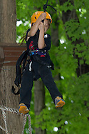Town of Wallkill, New York - Jaida Macaluso swings off a platform after climbing a tree during a Ninja Warrior Day Camp trip to Ring Homestead Camp on July 8, 2014.