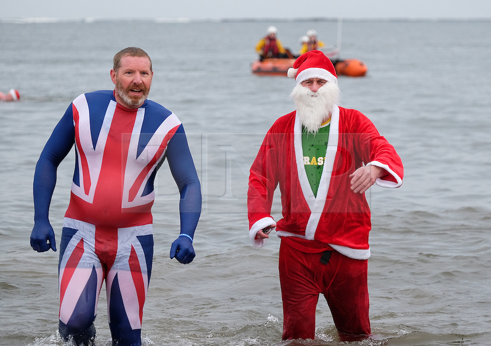 © Licensed to London News Pictures. <br /> 26/12/2014. <br /> <br /> Redcar, United Kingdom.<br /> <br /> Hundreds of people, many in fancy dress attend the annual Boxing Day dip event at the beach in Redcar, Cleveland. Many of those taking part in the popular event help to raise hundreds of pounds for various charities. <br /> <br /> Photo credit : Ian Forsyth/LNP