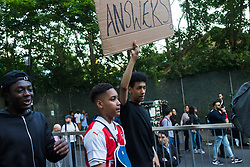 London, June 16th 2017. Local residents and supporters take to the streets around the scene of the Grenfell Tower fire disaster ahead of a vigil scheduled for 10 PM. Members of the community are demanding justice and for the authorities to better inform them as to casualties and alternative accommodation following the tragedy. In several areas of London there have been protests.