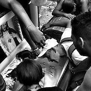 Caracas - Venezuela. Friends and relatives of Omar Martinez, 18 years old, mourn him at South General Cemetery in Caracas. Omar was killed by police forces after he got detained by the police together with a suspect of phones robbery. Both were killed in what police said was a fire exchange 3 hours after their detention.