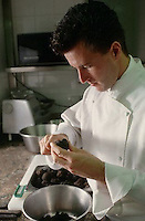February 1997, Paris, France --- Chef Slicing Truffles --- Image by © Owen Franken/CORBIS