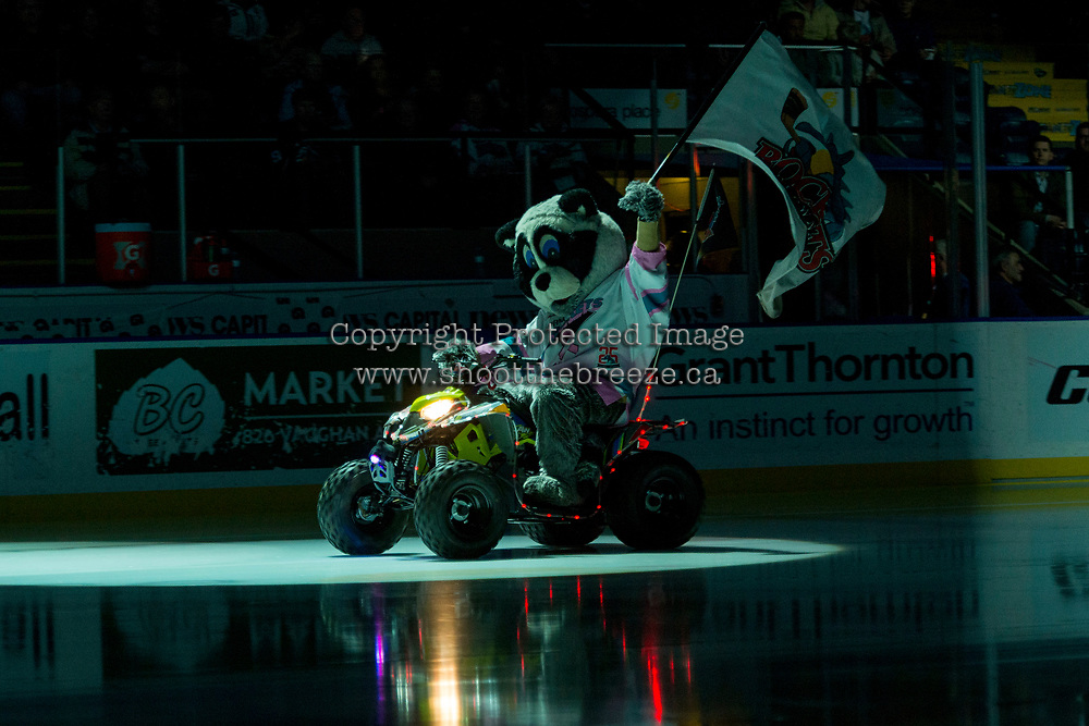 KELOWNA, CANADA - MARCH 10: Rocky Raccoon, the mascot of the Kelowna Rockets enters the ice against the Kamloops Blazers on March 10, 2018 at Prospera Place in Kelowna, British Columbia, Canada.  (Photo by Marissa Baecker/Shoot the Breeze)  *** Local Caption ***