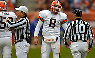 MORNING JOURNAL/DAVID RICHARD.Cleveland quarterback Trent Dilfer, center, has words with head linesman Ron Phares as referee Walt Coleman, left, signals a false start on the Browns yesterday in the third quarter.