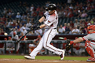 PHOENIX, AZ - JUNE 26:  Chris Herrmann #10 of the Arizona Diamondbacks hits a solo home run during the first inning against the Philadelphia Phillies at Chase Field on June 26, 2017 in Phoenix, Arizona.  (Photo by Jennifer Stewart/Getty Images)