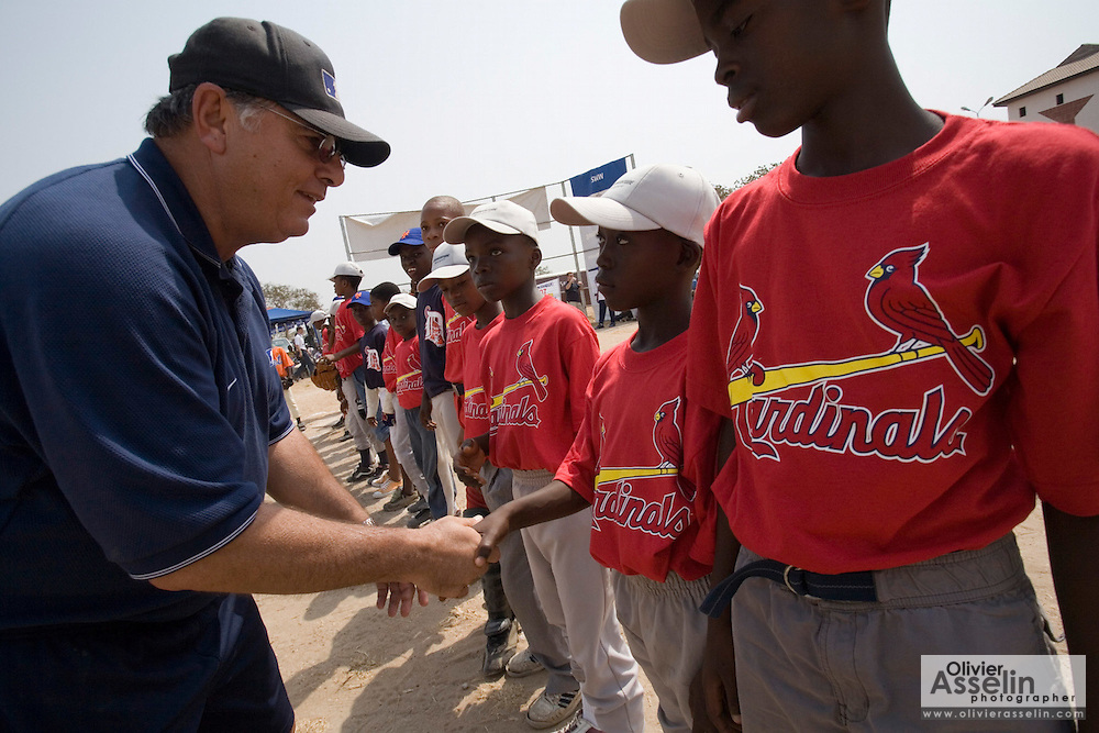 Former MLB player Tony Torchia greets Ghanaian boys before an exhibition baseball game in the city of Tema, roughly 35 km east of Ghana's capital Accra on Saturday February 3, 2007. The game was being held on the occasion of the visit of a delegation from the American Major League Baseball Association made possible by the African Development Foundation, a non-profit organization that supports little league projects in selected African countries.
