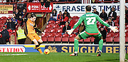 Andrew Robertson composes himself to fire Hull into the lead during the Sky Bet Championship match between Brentford and Hull City at Griffin Park, London, England on 3 November 2015. Photo by Michael Hulf.