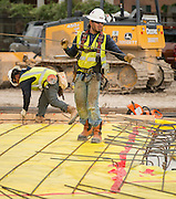 Contractors make preparations to pour the slab at the new North Houston Early College High School, May 5, 2015.