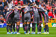 Leeds United players huddle during the EFL Sky Bet Championship match between Charlton Athletic and Leeds United at The Valley, London, England on 28 September 2019.