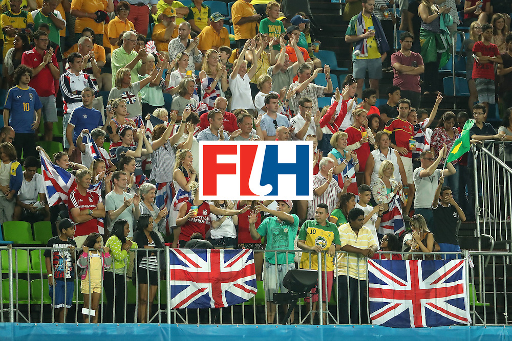 RIO DE JANEIRO, BRAZIL - AUGUST 09:  Fans of Great Britain cheer following the hockey game against Brazil on Day 4 of the Rio 2016 Olympic Games at the Olympic Hockey Centre on August 9, 2016 in Rio de Janeiro, Brazil.  (Photo by Christian Petersen/Getty Images)