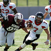 Lee defensive lineman Poly Abalos charges after Colleyville Heritage quarterback Jeff Calvert during a 52-20 loss to the Panthers..photo by Gary Rhodes 08/29/09