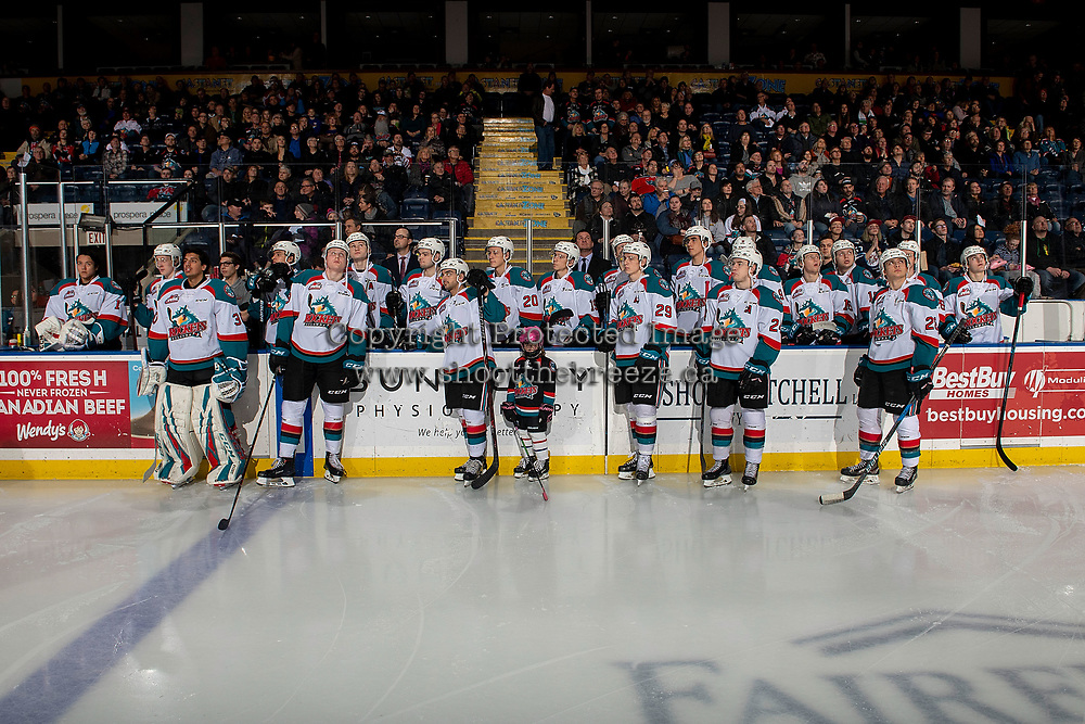 KELOWNA, CANADA - JANUARY 19: The Kelowna Rockets stand at the bench watching a presentation on the jumbo tron with the Pepsi Player of the Game against the Prince Albert Raiders  on January 19, 2019 at Prospera Place in Kelowna, British Columbia, Canada.  (Photo by Marissa Baecker/Shoot the Breeze)