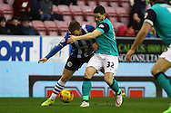 Adam Forshaw of Wigan Athletic and Craig Conway of Blackburn Rovers battle for the ball. Skybet football league championship match , Wigan Athletic v Blackburn Rovers at the DW Stadium in Wigan, Lancs on Saturday 17th Jan 2015.<br /> pic by Chris Stading, Andrew Orchard sports photography.