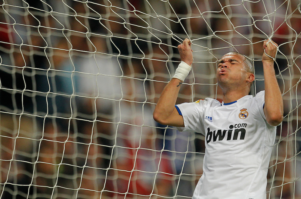 Real Madrid's Pepe from Portugal, reacts after missing a goal during his Spanish La Liga soccer match against Barcelona at the Santiago Bernabeu stadium in Madrid, Saturday, April 16, 2011.